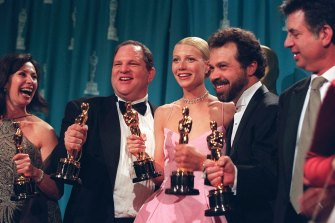 The now disgraced Harvey Weinstein, second left, celebrates alongside Gwynneth Paltrow after Shakespeare in Love won the best picture Oscar in 1999.