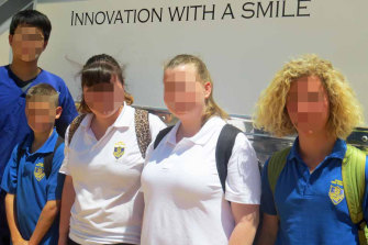 Children from Cowra High School pose for a photo after visiting the Smiles Onsite van in 2014.