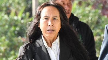 Mr Mokmool's mother Supaporn Chomphoo arrives at the inquest on Monday.