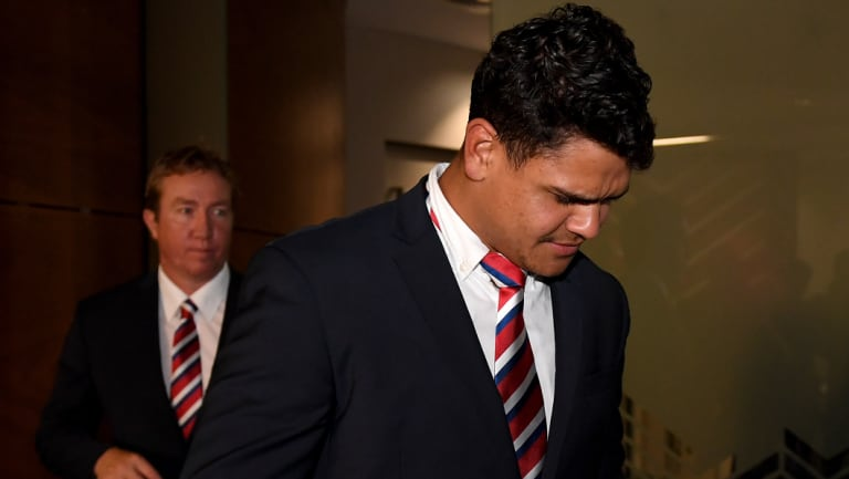 No comment: Latrell Mitchell and Trent Robinson leave the hearing on Tuesday  night.