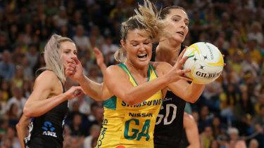 Gretel Tippett under pressure from Karin Burger in Australia's series-deciding win over New Zealand.