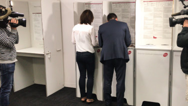 Matthew Guy and his wife Renae cast their votes 10 days ahead of the November 24 election.