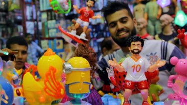 Egyptians buy traditional Ramadan decoration items 'Fanous' depicting the Egyptian Liverpool soccer player Mohamed Salah at a market in Cairo.