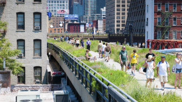 People stroll along High Line park in New York.