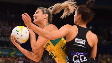 Australia's Gretel Tippett under pressure from Karin Burger.