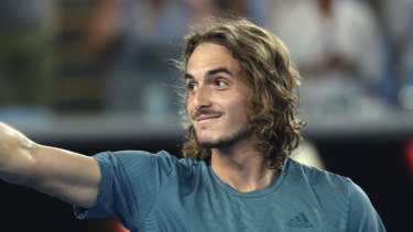 Greece's Stefanos Tsitsipas celebrates after defeating Georgia's Nikoloz Basilashvili  on Friday.