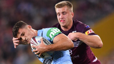 Gotcha: Cameron Munster  runs down Nathan Cleary in Origin I.