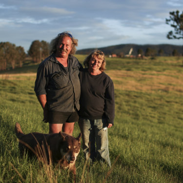 Brad and Gail Rayer, with their dog Wally, estimate they will lose $1 million from the bushfires.