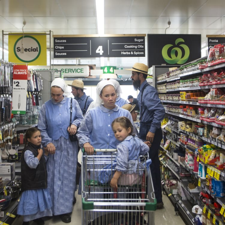 The McCallums go shopping in Woolworths. Elizabeth pushes Abi in the trolley.