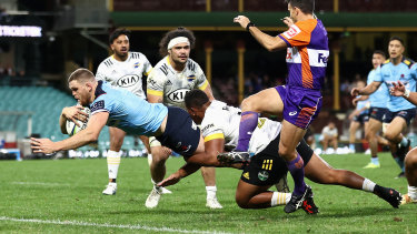 Lachlan Swinton of the Waratahs scores against the Hurricanes at the SCG.