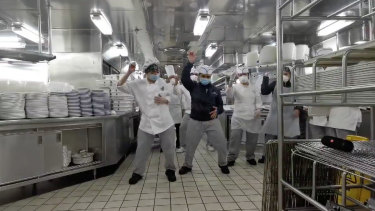 Cruise ship chef Mae Fantillo and her team keep up morale by broadcasting a flash dance in the kitchen.