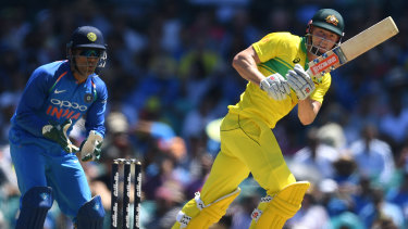 Change of pace: Shaun Marsh enjoys a spread field to make some runs against India at the SCG.