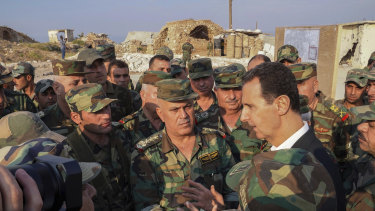 Syria's President Bashar al-Assad speaks with his troops in Habeet int he province of Idlib.