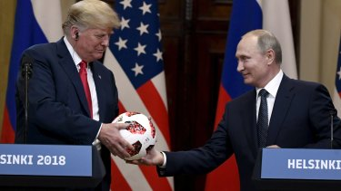 Putin presented a soccer ball to Trump during the press conference.