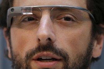 Google co-rounder Sergey Brin wears Google Glass glasses in 2013.