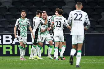Western United celebrate with Besart Berisha after the striker opened the scoring.