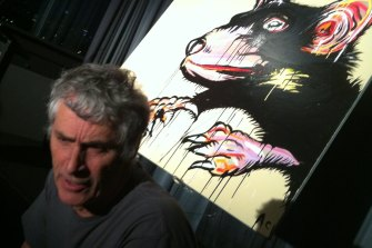 Paul Andrew with a Tassie devil painting by Adam Cullen.