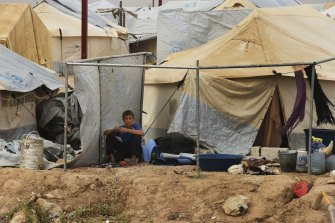 A young male sits outside a tent in the foreign annex in al-Hawl camp in north-east Syria last year.