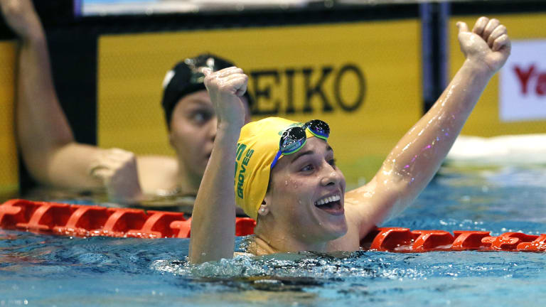 Anchorwoman: Madelin Groves celebrates after holding off her American rival to win gold in the women's 4x200m freestyle relay.
