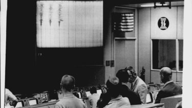 Controllers in mission control watch the seismograph readings from the Apollo 13.