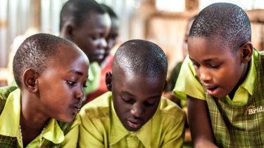 Students in class at a school in Uganda run by Bridge International.