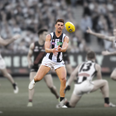 Scott Pendlebury disposes of the ball in round six against Essendon.