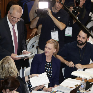 The then treasurer Scott Morrison with the ABC's Laura Tingle (left) and Leigh Sales during the 2018 Budget lock-up.