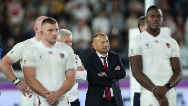 A dejected Jones stands with his team after the World Cup final defeat.