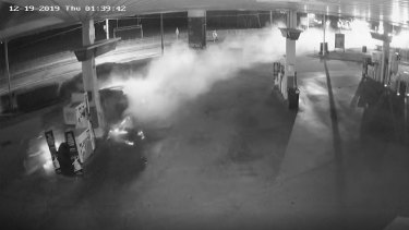 A still-image from the service station CCTV footage as the car destroys the fuel bowser.