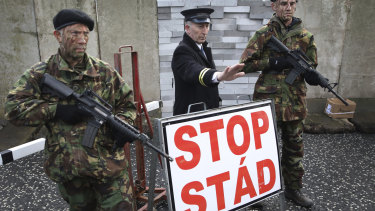 Demonstrators hold banners on the Northern Ireland/Republic of Ireland border, near Newry in Northern Ireland, on Saturday.