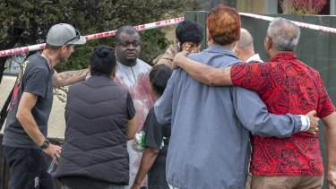 A survivor from the shooting comes through a cordoned off area.
