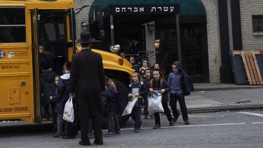 Children from a Jewish school in Williamsburg, Brooklyn, board a school bus in April.