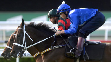 Sitting pretty: Winx goes to the line with Egg Tart under a stranglehold from Hugh Bowman.