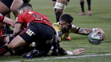 Half measures: TJ Perenara scores for the visitors, but he was left to rue a crucial late error.