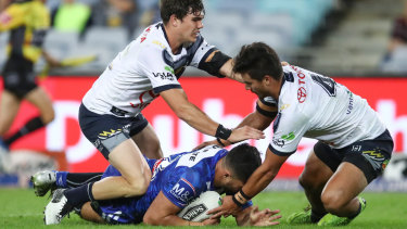Body on the line: : Corey Harawira-Naera scores a try and cops a stray knee on the way  from Jake Clifford.