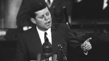 "US president John F. Kennedy speaks in 1961, urging congressional approval of additional funds to bolster the space, programs: ""I believe this nation should commit itself to achieving the goal, before the decade is out, of landing a man on the moon and returning him safely to Earth."""
