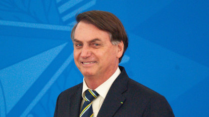 Twitter blocks Bolsonaro posts as he visits market to campaign against isolation