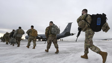 Airmen and soldiers from the Alaska National Guard prepare to depart from Joint Base Elmendorf-Richardson on Sunday to assist with Joe Biden's inauguration.
