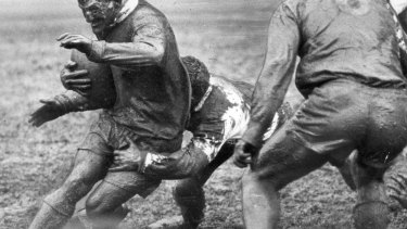 Summons is tackled by St George half George Evans in the 1963 grand final.