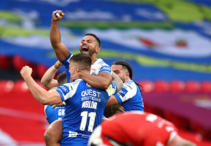 ruise Leeming of Leeds Rhinos celebrates victory with teammates at full-time during the Coral Challenge Cup Final match between Leeds Rhinos and Salford Red Devils at Wembley Stadium