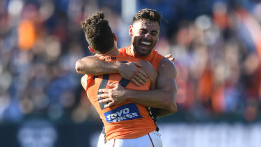 Brothers in arms: Stephen Coniglio (right) embraces Josh Kelly after GWS rolled Geelong in one of their most important victories as a club.
