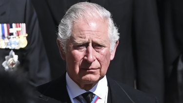 Prince Charles sheds a tear as he follows the coffin at Windsor Castle.