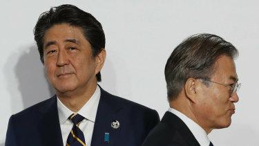 Japanese PM Shinzo Abe, left, and South Korean President Moon Jae-in.