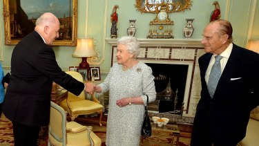 Sir Peter Cosgrove with the Queen and Prince Philip at Buckingham Palace in 2014.