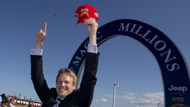 Victory: Bjorn Baker celebrates one of his biggest wins, Unencumbered's success in the 2014 Magic Millions.