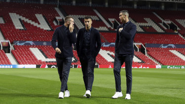 Familiar ground: Ronaldo (right) takes a look around Old Trafford.