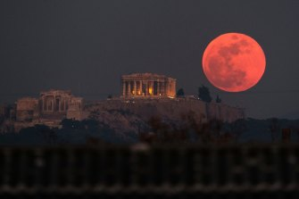 A super blood moon rises behind the 2500-year-old Parthenon temple on the Acropolis of Athens, Greece, in January 2018.