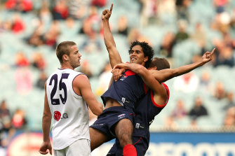 Aaron Davey and Brad Green celebrate a goal in the Demons' come-from-behind win against the Dockers at the MCG in 2008.