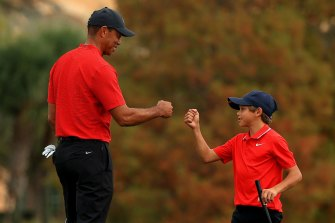 Woods and Charlie celebrate on the 18th.