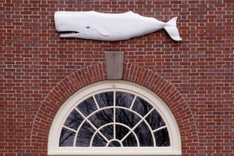 The likeness of a whale sits above the entrance to the New Bedford Whaling Museum.